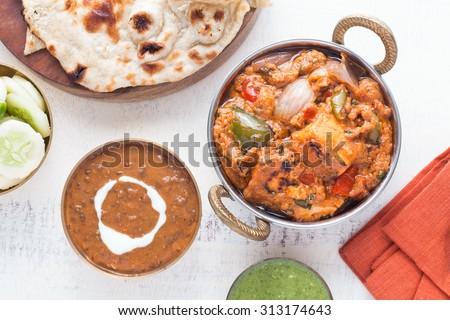 Indian Lunch with Paneer tikka masala, Dal Makhani, Naan, chutney and salad. - stock photo