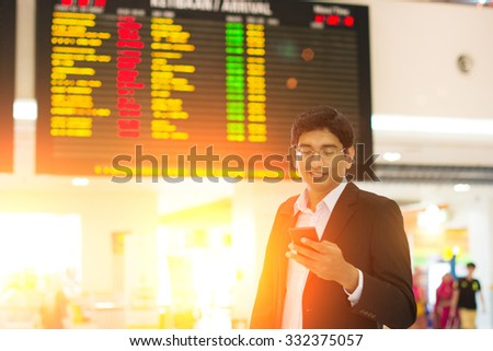 indian male at airport terminal in the early morning - stock photo