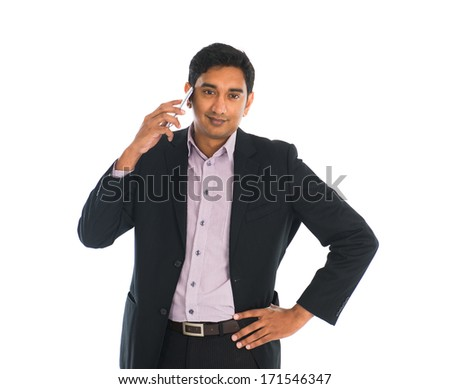 indian male business man on a phone with white background - stock photo