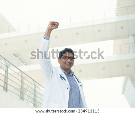 indian male doctor celebrating success , slight vintage tone - stock photo