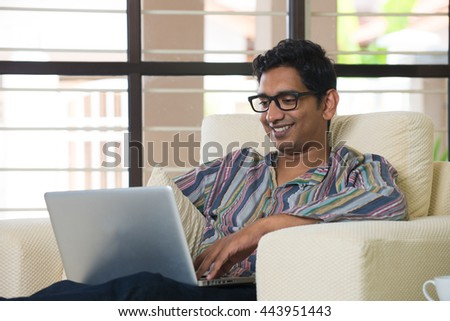 indian male using laptop - stock photo