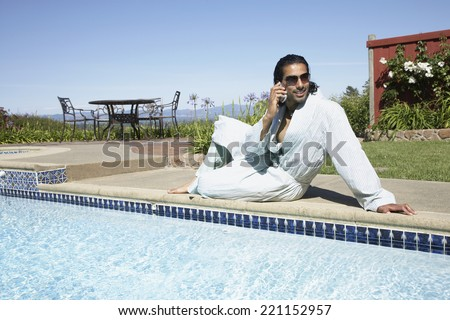 Indian man talking on cell phone - stock photo