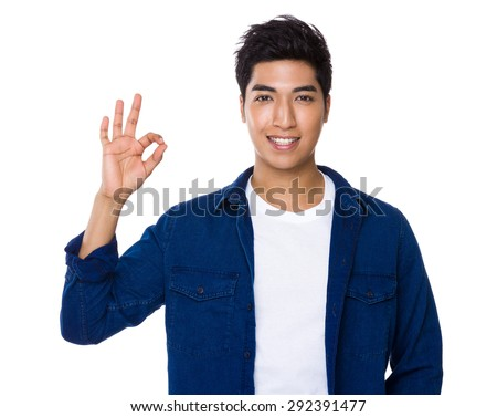 Indian man with ok sign gesture - stock photo