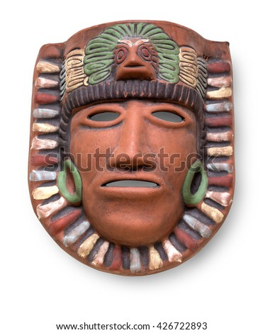 Indian Mayan Aztec ceramic painted mask with feather isolated on white with clipping path - stock photo