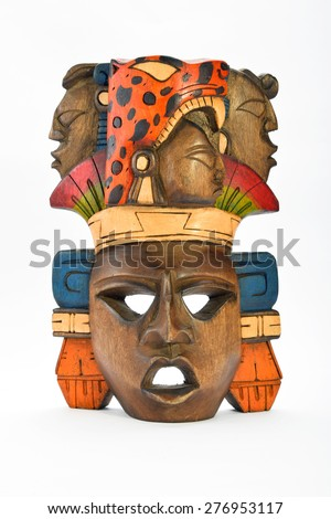 Indian Mayan Aztec wooden painted mask with roaring jaguar and human profiles isolated on white background (front, full face, vertical) - stock photo
