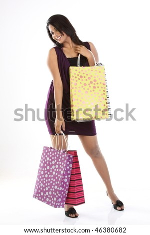 Indian modern girl with shopping bags - stock photo