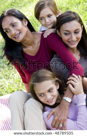 Indian mother with three beautiful mixed-race children - stock photo