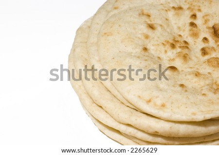 Indian nan bread stack isolated on white, shawarma wrap - stock photo
