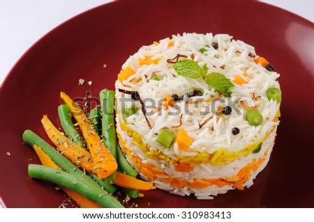 Indian rice dish vegetarian pulao ,Shai Pilau or Vegetable Pilau or Indian Biryani  colorful  Vegetable Pilau - stock photo