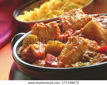 Indian rogan josh curry with pilau rice - stock photo
