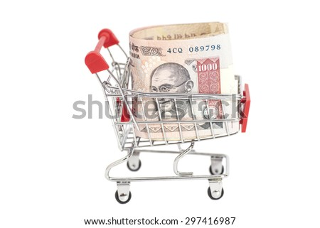 Indian 1000 rupees in shopping cart isolated on white background - stock photo