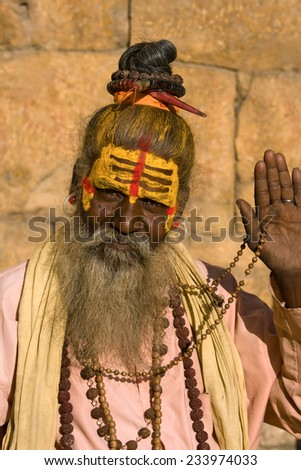 Indian sadhu - holy man. Jaisalmer, Rajasthan, India. - stock photo