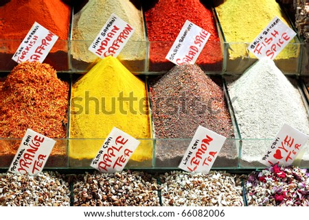 Indian saffron and colorful spices on display - stock photo