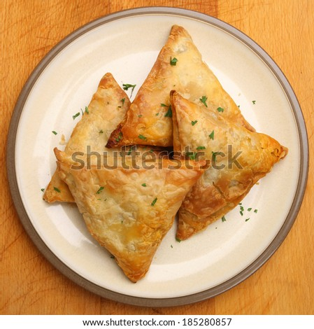 Indian samosas filled with chicken tikka curry mixture. - stock photo