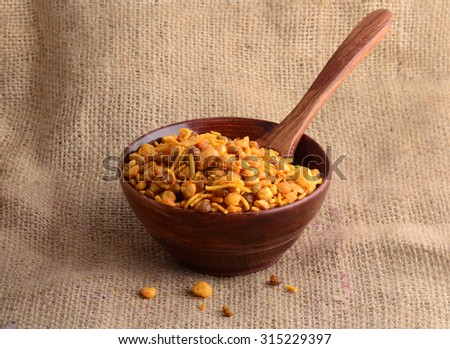 Indian Snacks : Mixture (roasted nuts with salt pepper, Spice, pulses, green peas)  - stock photo