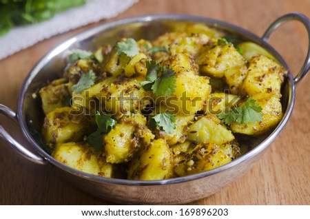 Indian spiced potato curry - stock photo