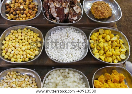 Indian spices and nuts - stock photo