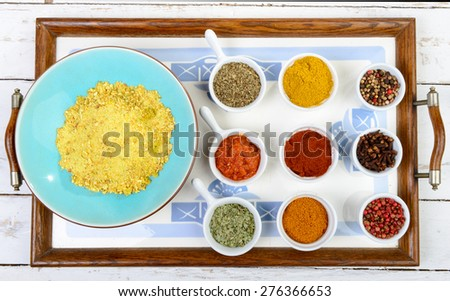 Indian spices assortments on a tray - stock photo