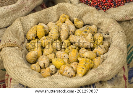 Indian spices ginger at  market in sack, Kerala state, India - stock photo