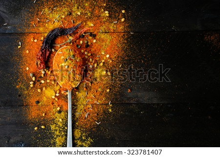 Indian spices selection over dark wooden table. Food or spicy cooking concept, Healthy eating Background. - stock photo
