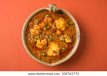 indian spicy food Gobi Masala or gobi fry or cauliflower curry, served in an indian main course - stock photo