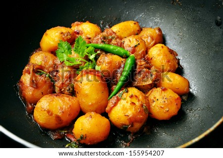 Indian spicy potato curry - stock photo