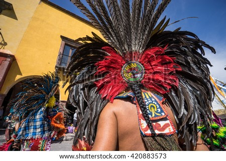 indian street dancer in Mexico wearing traditional feather headdress - stock photo