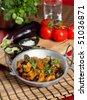Indian style eggplant/aubergine dish with fresh coriander on top - stock photo