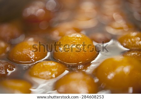 "Indian sweet dish called "" gulab jamun "". - stock photo"