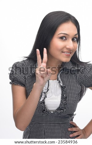 Indian teenage girl showing two fingers - stock photo
