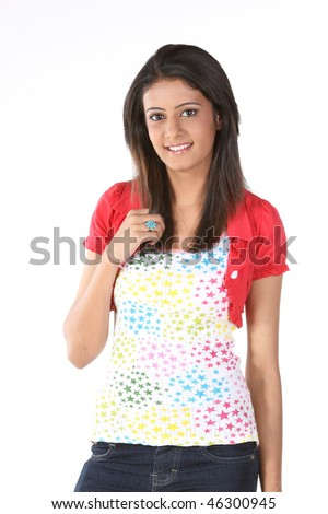 Indian teenage girl with red jacket - stock photo