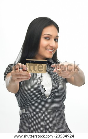 indian  teenage girl with the credit card - stock photo