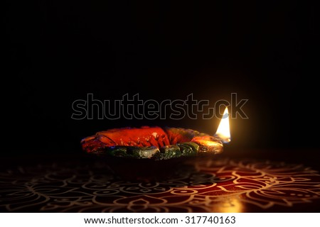 Indian Traditional kolam with Oil Lamp - stock photo