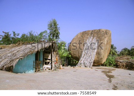 indian village and rock in hampi, india - stock photo