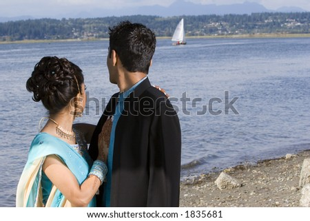 Indian wedding bride and groom at seaside - stock photo