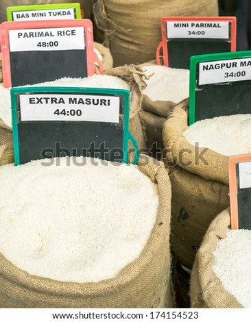 Indian wholesale market selling spices, herbs and grains. - stock photo