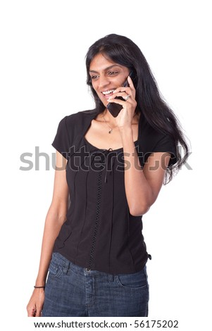 Indian woman cheerfully listening to her cellphone - stock photo