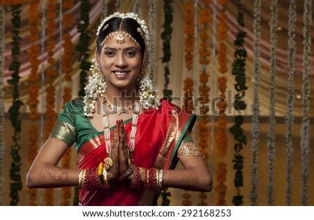 Indian woman greeting Namaste - stock photo