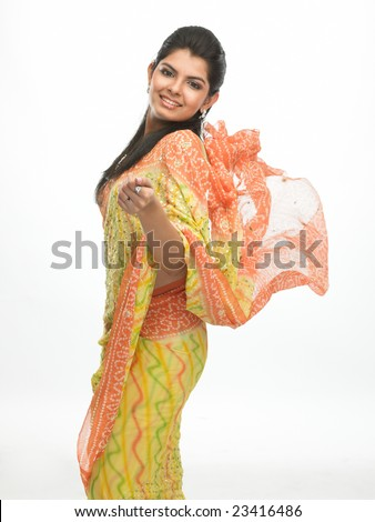 Indian woman in flying sari with happy expression - stock photo