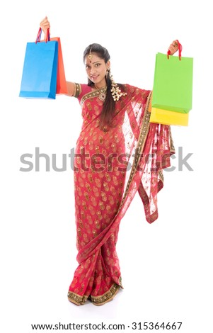 Indian woman in traditional sari shopping for diwali festival, full length standing isolated on white background. - stock photo