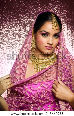 Indian woman laying in luxury ethnic interior. - stock photo