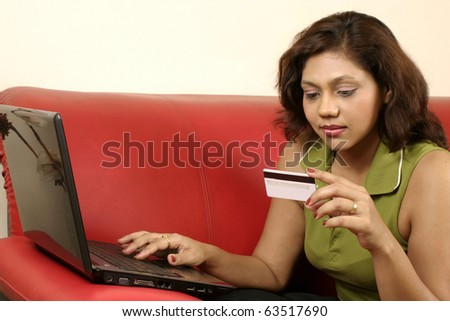 Indian Woman using credit card online - stock photo