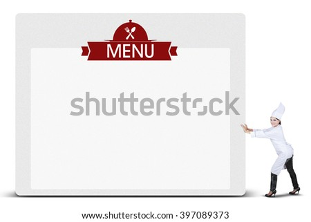 Indian woman wearing the chef clothes and pushes a billboard with a text menu, isolated on white background - stock photo