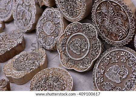 Indian wood carving printing block stamp for textile design, completely hand made - stock photo