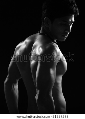 Indian young body builder posing to the camera. - stock photo