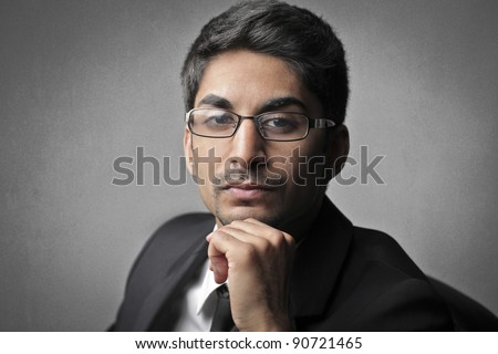 Indian young businessman - stock photo