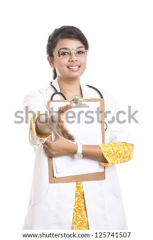 Indian young female doctor giving handshake on white. - stock photo