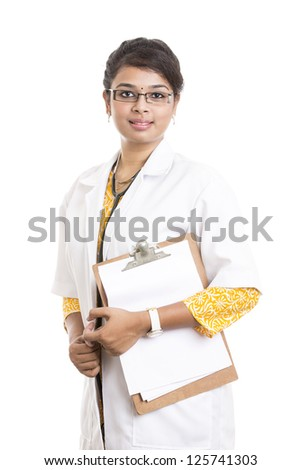 Indian young female doctor with notepad on white. - stock photo
