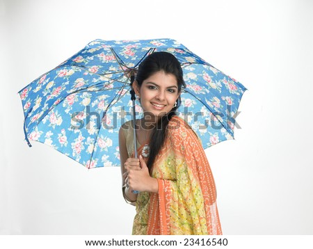Indian young girl under blue umbrella - stock photo