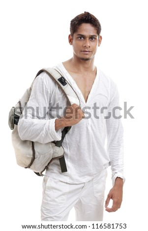Indian young man posing with bag on white background. - stock photo